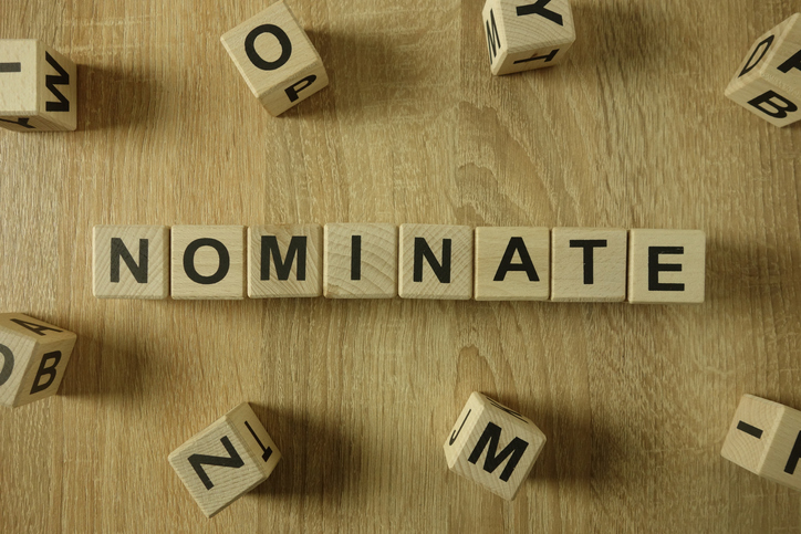Nominate word from wooden blocks on desk