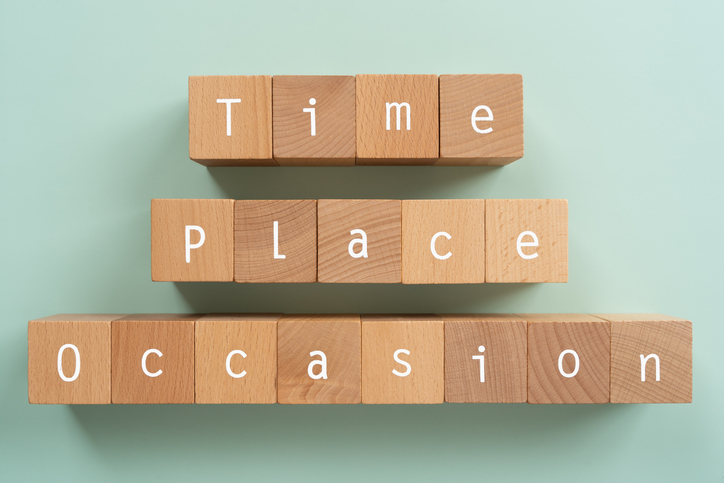 """TPO; Wooden blocks with """"Time Place Occasion"""" text of concept."""