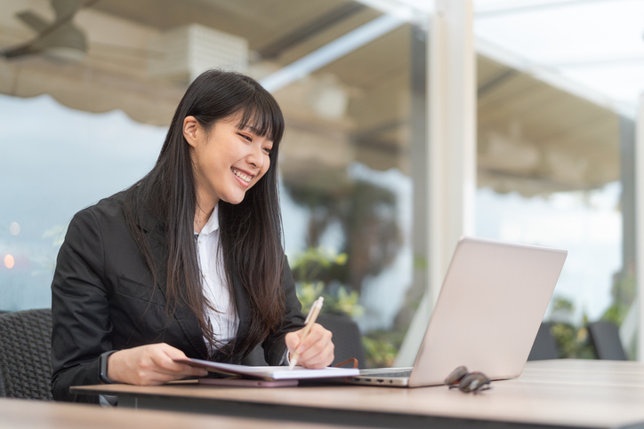 Business Asian woman working on computer in cafe outdoor - Young female entrepreneur using laptop in office - Professional job and entrepreneurship concept