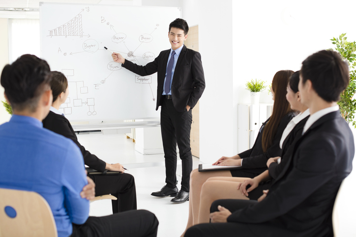 Businessman presenting new project to partners in office