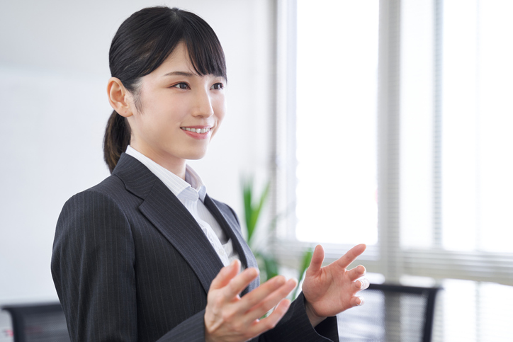 A Japanese female businesswoman presenting at the office