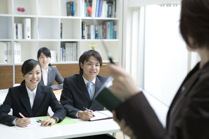 Male and female new employees gaining on-the-job training