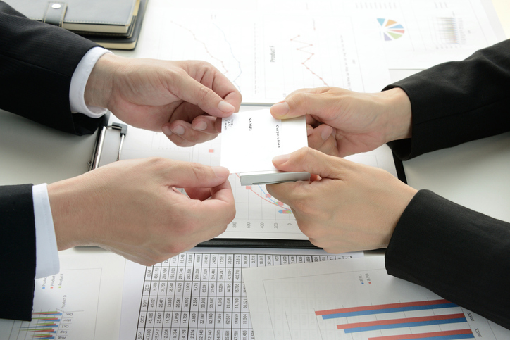 Business men exchanging business card