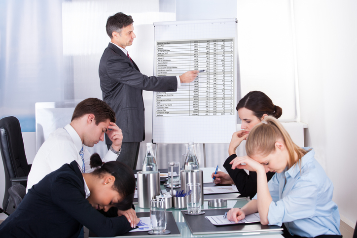 Bored Businesspeople At Presentation With Colleagues In Office