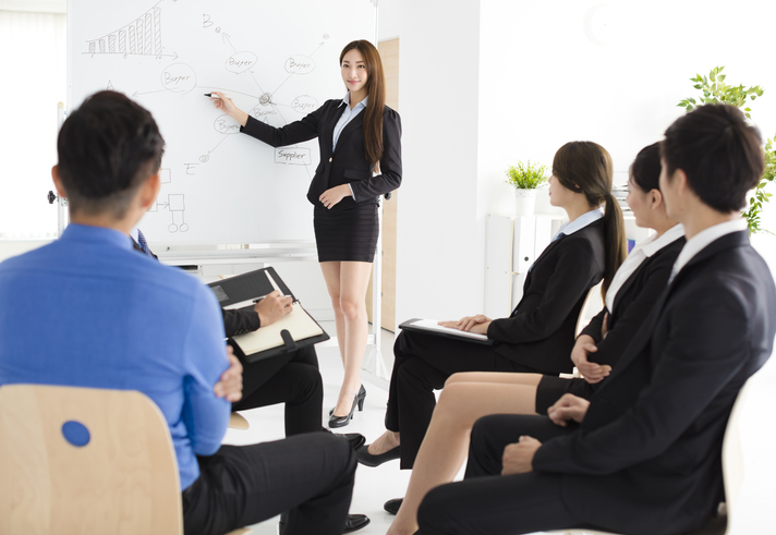 Businesswoman presenting new project to partners in office