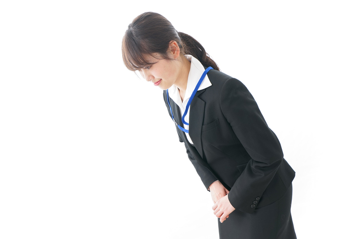 Business woman bowing to someone