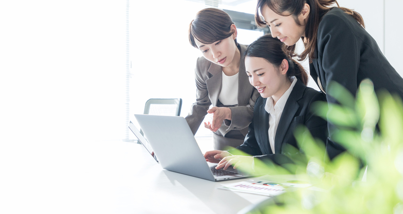 Three businesswomen working in the office. Positive workplace concept.