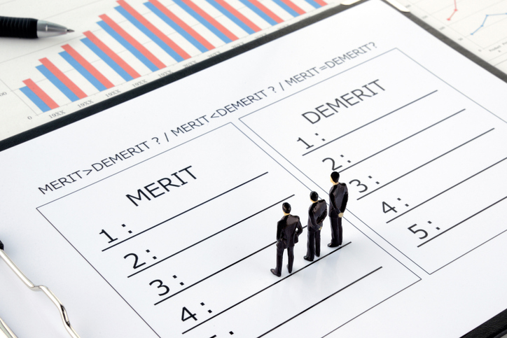 Business man discussing on comparison of merit and demerit
