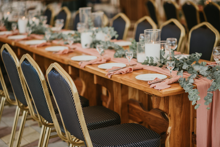 Beautiful wedding table setting decorated with flowers and candles