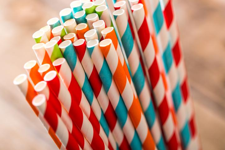 Striped paper straws in glass