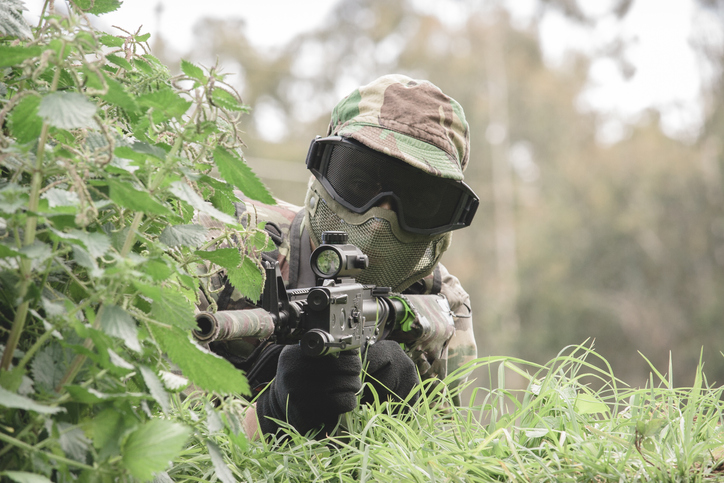 Soldier of airsoft hiding from his opponents