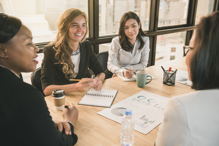 Japanese businesswoman having a meeting with international team, diverse female leader concept