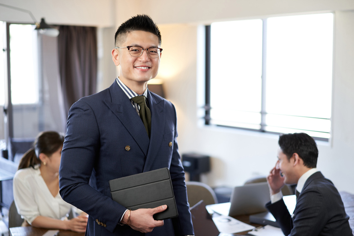 A smiling man at an English conversation meeting between Asians and Latins