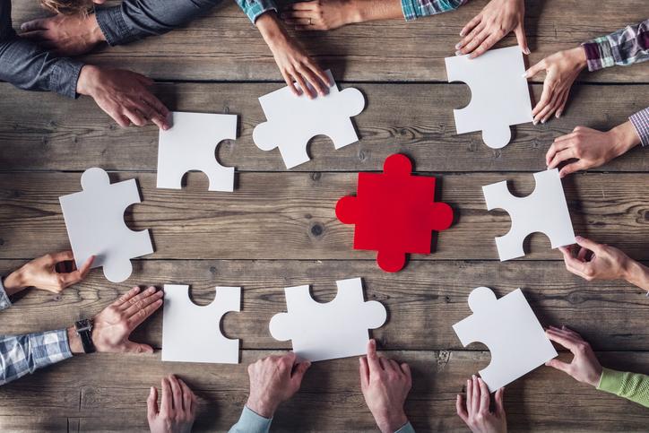 Hipster business successful teamwork concept, business group assembling jigsaw puzzle